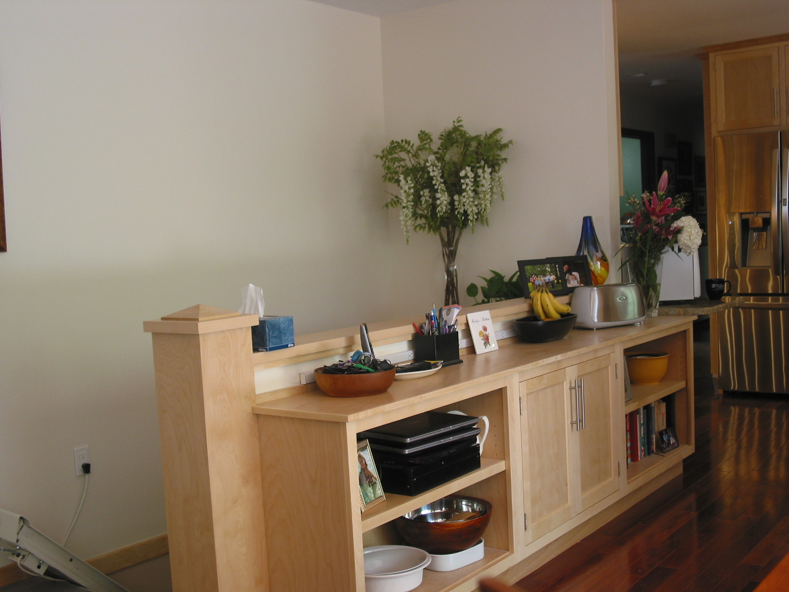 Banister and storage cabinet