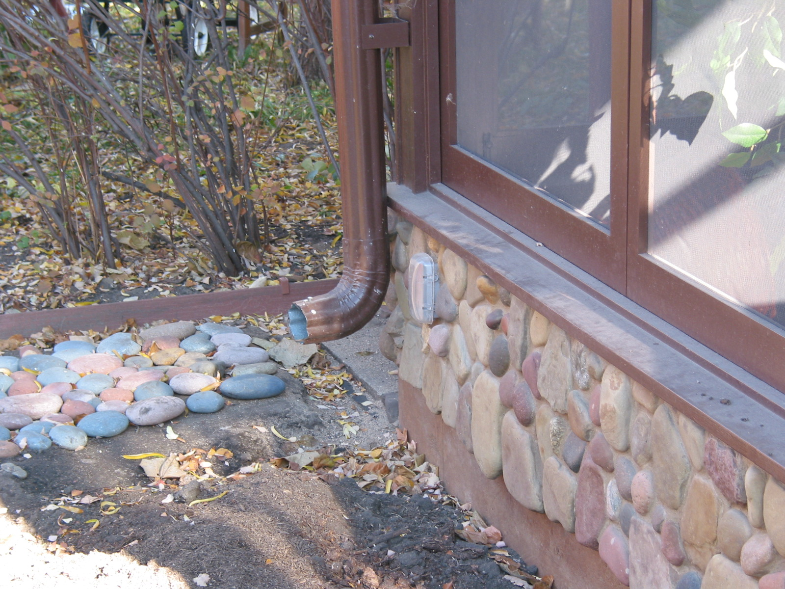 Stone wall of porch built by Whole Builders